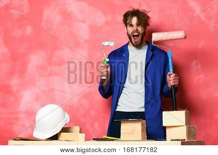 Shouting Man Holding Paint Rollers