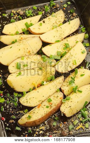 Potato. Delicious food with spices ready for cooking. Testy dish.