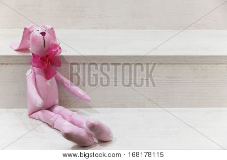hare pink cloth on a wooden background