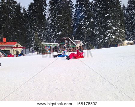Borovets, Bulgaria - January 30, 2017: People sledging at ski resort Borovets