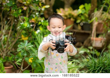Handsome Asian Kid Take A Photo By Dslr Camera