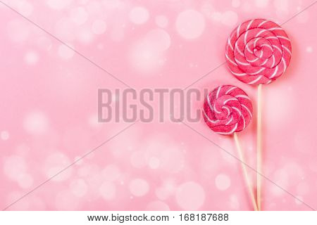 Two Lollipop On Pink Background.