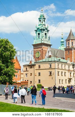 Krakow, Poland - June 08, 2016: Tourists Visiting Famous Wawel Royal Castle And Cathedral In Krakow,