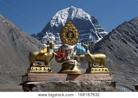 The main Buddhist symbol Dharmachakra on the roof of Buddhist monastery Driraphuk gompa at the North Face of sacred Mount Kailash in Western Tibet.