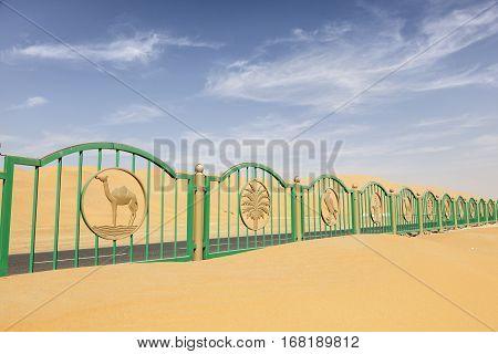 Fence at the Moreeb Dune Liwa oasis area Emirate of Abu Dhabi. United Arab Emirates Middle East
