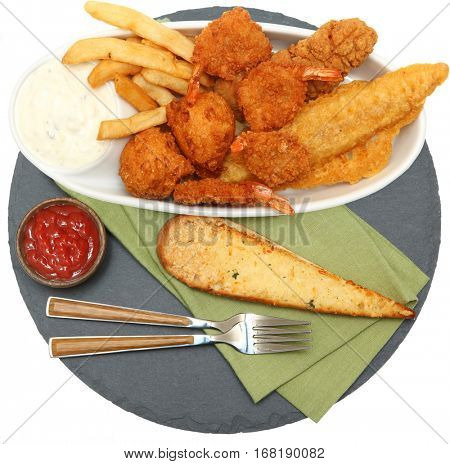 Southern Fried Fish and Chicken with garlic bread, tarter sauce, fries, hushpuppies and shrimp.