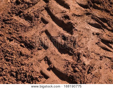 Texture of roy tractors on dry ground