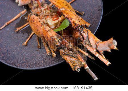 Barbeque lobster, Barbeque lobster on black background.