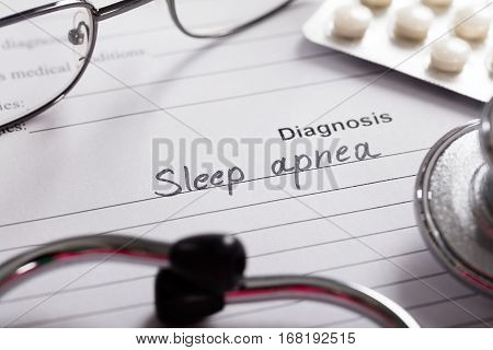 Diagnosis Sleep Apnea On White Paper With Drugs And Stethoscope In Background