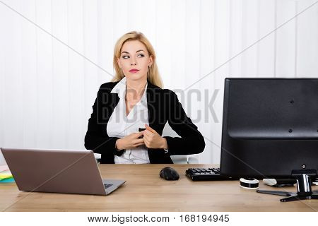 A Suspicious Businesswoman Stealing Stapler Secretly In Her Pocket At Office