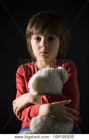 Sad Little Child, Crying, Hugging Stuffed Toy