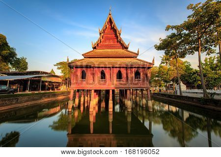 The library on stilts in Wat Thung Si Muang temple in Ubon Ratchatani in Isan north eastern Thailand.