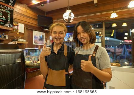 PATTAYA, THAILAND - CIRCA FEBRUARY, 2016: indoor portrait of staff at Coffee Mania coffee shop in Pattaya.