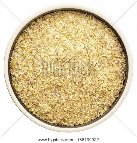 golden flax meal in a ceramic round bowl isolated on white