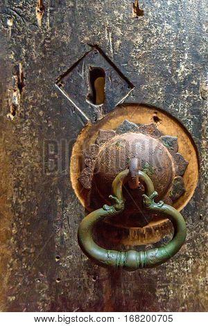 Antient door handle at gates of cave temple in Dambulla, Sri Lanka
