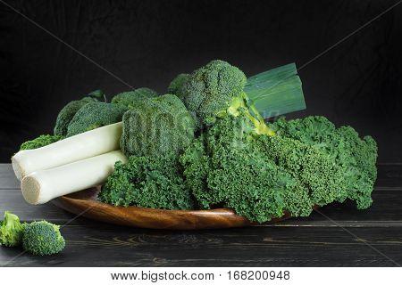 Green winter fresh organic superfood - Kale green cabbage broccoli and leeks prei