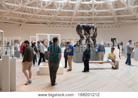 MEXICO CITY,MEXICO - DECEMBER 25,2016 : Visitors at the Auguste Rodin section of the Soumaya museum of art in Mexico City