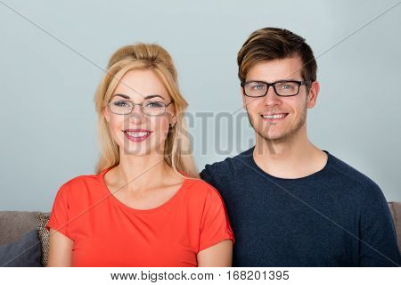 Portrait Of Young Smiling Couple Wearing Glasses