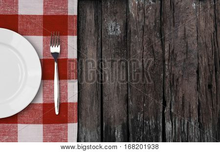 old wood table with dinner plate setting top view