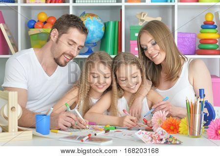 big happy family drawing together at kids room