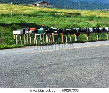 Long row of mail boxes await the postal delivery to this country road in rural Montana.