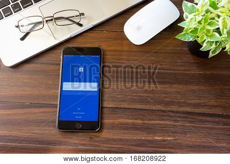 BANGKOK THAILAND - march 5 2017 : Login Screen Facebook icons on Apple iPhone 6. largest and most popular social networking site in the world.