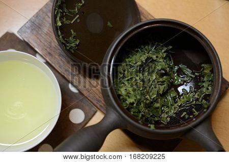 Green Tea Leaf In A Tea Pot