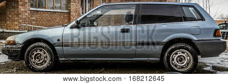 Old car, old blue car, two-door hatchback, side view, grunge car