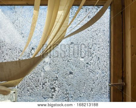 Window frost and a curtain or window shutter closeup indoor cropped shot