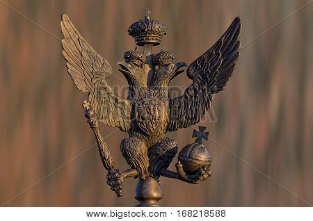 double headed Russian eagle in bronze in the crown with scepter and orb in its claws