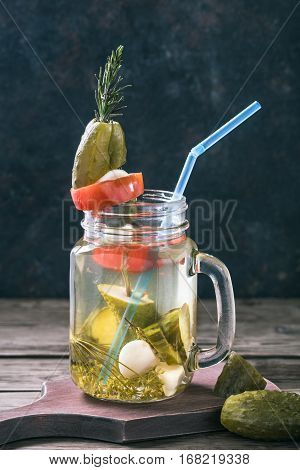 Jar of pickled cucumber brine.Traditional Russian cure for hangover. Toned