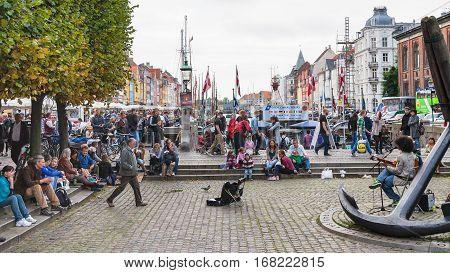 People On Square In Nyhavn Area In Copenhagen