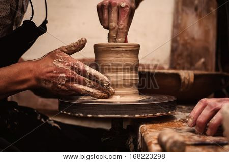 close up Hands working on pottery wheel