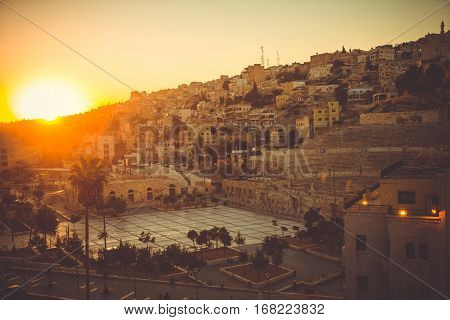 Photo of Cityscape Amman downtown at dawn. Capital of Jordan. Tourism concept. Arab city. Toned. Roman theater Amman symbol. This city was initially built on seven hills. Old Town