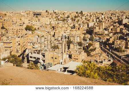 Photo of the Amman overview, Jordan, Middle East. Travel concept. Summer vacation. Urban landscape. Residential area. Arabic architecture. Eastern city