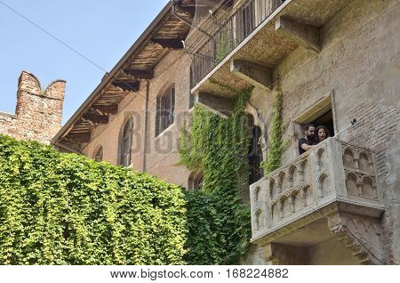 VERONA, ITALY - AUGUST 6, 2014: Couple doing a selfie at balcony of Juliet in Verona Italy