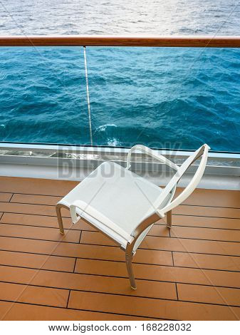 empty chair on balcony of cruise liner