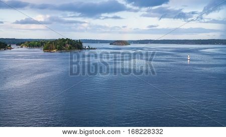 panorama of Baltic Sea with green islands in fiord in autumn evening Sweden