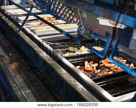 self-service buffet with hot american breakfast - bacon fried eggs scrambled eggs fried sausages etc