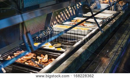 self-service buffet with hot breakfast - bacon fried eggs scrambled eggs fried sausages etc