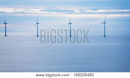 Travel to Denmark - calm water of Baltic Sea with offshore wind farm Middelgrunden in Oresund near Copenhagen city in blue autumn morning