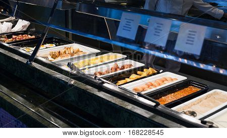 self-service buffet with full breakfast - bacon fried and scrambled eggs fried sausages potato naggets boiled eggs toasts porridge etc
