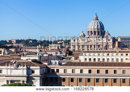 travel to Italy - view of St Peter's Basilica in Vatican city and buildings in Borgo district in Rome Castel of Holy Angel