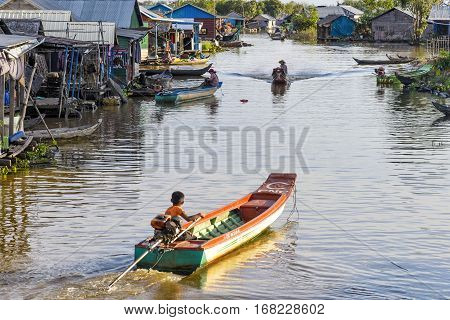 Tonle Sap lake, Cambodia - January 04, 2017: View of a floating village of fisherman. About 80,000 people live on the lake's water permanently, spread out over 170 floating villages