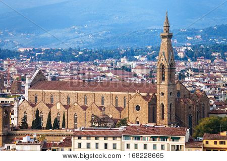 travel to Italy - above view of Basilica di Santa Croce in Florence city from Piazzale Michelangelo in autumn evening