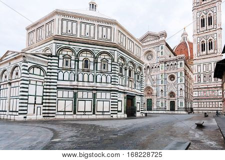travel to Italy - Square San Giovanni with Baptistery (Battistero di San Giovanni Baptistery of Saint John) and Duomo Cathedral Santa Maria del Fiore with Giotto's Campanile in Florence in morning
