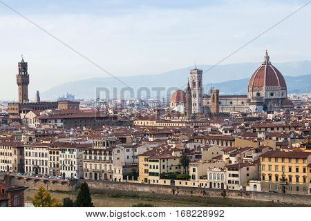travel to Italy - above view of old city of Florence from Piazzale Michelangelo in autumn evening