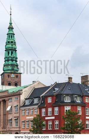 Travel to Denmark - view of Tower of St Nikolaj Church and urban houses in Copenhagen city in autumn day