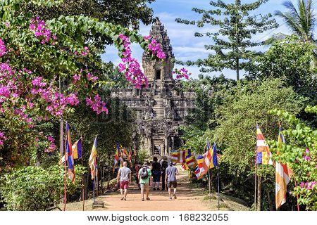 Rolous, Cambodia - January 04, 2017: A group of tourists approaching Bakong temple. Bakong is the first temple mountain constructed by the Khmer empire at Angkor near modern Siem Reap in Cambodia