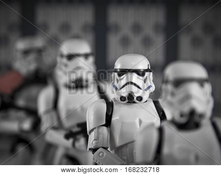 A row of Hasbro Black Series 6 inch Star Wars Stormtrooper action figures lining up in a row, shallow depth of field.
